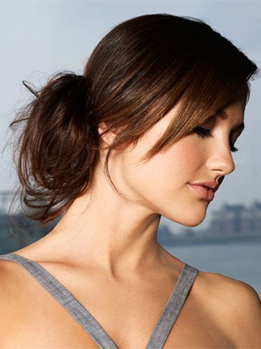 "<b>GET THE LOOK:</b> ""The key to giving your bun a boost is pushing it over to one side,"" says Blandi. Exaggerate the effect by doing a deep side-part. Comb a straightening balm into damp hair, then gather it into a low ponytail above your ear. Wrap the tail around the base to form a bun, and bobby-pin small sections to your head, letting some pieces slip out."