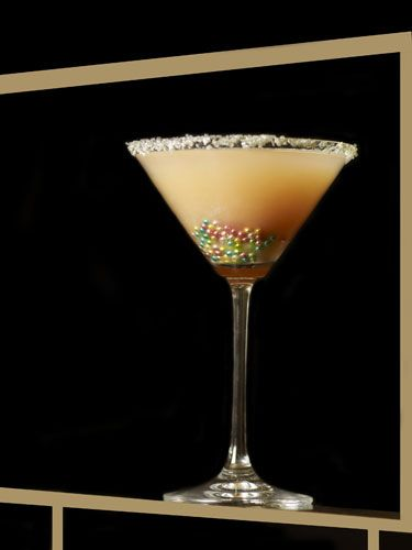 """<p>2 oz. vodka<br /> 2 oz. white peach puree <br /> 1 oz. ginger-infused simple syrup <br /> ½ oz. lemon juice<br /> Silver and pink sanding sugar (for rim) <br /> Silver sugar beads</p>  <p>To make the peach puree, peel a peach and put it in a blender for about 10-15 seconds. To make the ginger syrup, bring half a cup of water and half a cup of sugar to a boil in a small saucepan. Throw in some fresh chopped ginger. Reduce, and stir until the mixture thickens. Strain out the ginger and let the syrup cool to room temperature Now, in a mixing glass, combine the peach puree, the ginger syrup, the lemon juice and the vodka; shake. Strain into a martini glass rimmed with the sanding sugar. (If you can't find sanding sugar in the baking aisle of your supermarket, substitute a small candy, like Nerds, crushed into powder.) Drop the silver sugar beads in the bottom of the glass for more """"bling.""""</p>"""