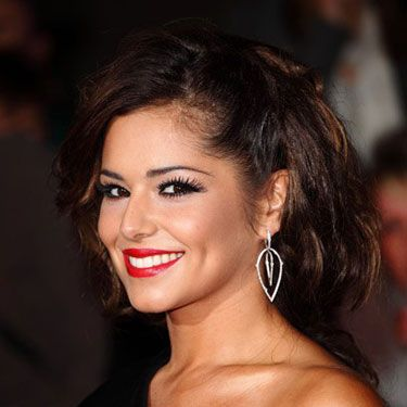 "<strong><a href=""http://www.askmen.com/celebs/women/singer/cheryl-cole-aka-cheryl-tweedy/index.html"" target=""_blank"">Why Men Say She's Hot:</a></strong> ""In addition to having a knockout physique, she also knows the way to a man's heart. She's reportedly said, 'As long as your hair's looking good and you've got a nice amount of makeup on, you've just got to throw your man on the bed and hop on.'"""