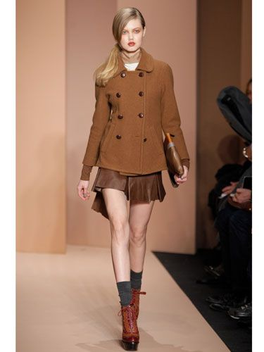 Expect schoolgirl-inspired clothes this fall, but with a twist: camel tones, edged up with leather, sexy socks, and sky-high platform oxfords.