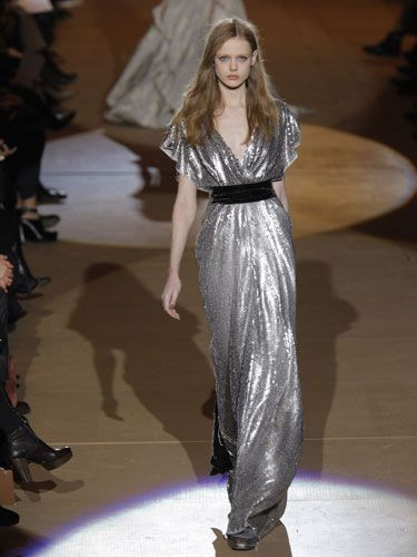 """Shimmer and shine are still strong this season. Don't be surprised to see """"day-gowns"""" as the line between fancy and casual gets blurred even more. We recommend throwing a blazer on over a long gown."""