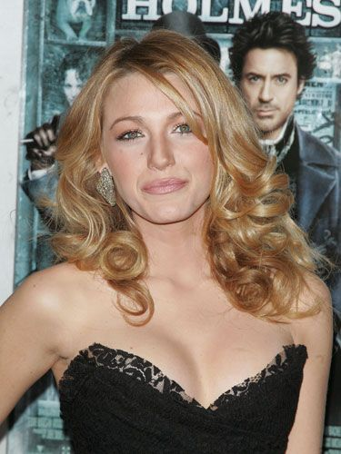 """Hands down, Blake's do is the top celeb style requested day after day, say our experts. To get her shine, """"always spray on a heat protectant before picking up a blow-dryer or iron,"""" says Jennifer Johnson, head stylist on the set of <i>Gossip Girl</i>, who likes <a href=""""http://www.aveda.com/templates/products2/spp.tmpl?CATEGORY_ID=CATEGORY11539&PRODUCT_ID=PROD5818&cm_mmc=GoogleProductSearch-_-Null-_-Null-_-Null"""" target=""""_blank"""">Aveda Brilliant Damage Control</a>, $15. To score serious volume, use a paddle brush to lift up your roots as you aim the blow-dryer directly at them. When roots are dry, pull a medium-size round brush through 2-inch sections to dry and smooth them. Finally, clamp medium-size sections around a large curling iron. Release when hair feels hot, then roll the curl up and secure it to your scalp with a bobby pin. Repeat until all hair is set, then remove the pins and run a wide-tooth comb through the curls."""