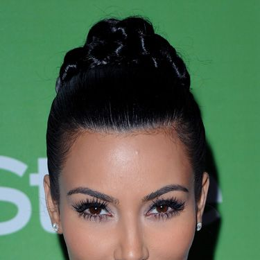 """Braids are really in right now, and they're very easy to make,"" Blandi says. Kim Kardashian's high-drama chignon is a fresh take on the trend. To score this look, first brush your hair back into a high pony on the crown and secure it with an elastic. Next, braid the tail. Gently coil the braid into a bun and fasten it in place with bobby pins."