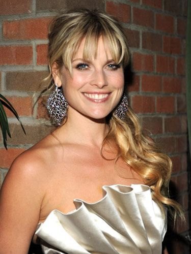 If you have eyebrow-skimming wispy bangs like Ali Larter, show them off by pulling your hair into a ponytail. But first, wrap large sections of hair around a curling iron for a dressier effect. If your locks are on the longer side, let the length of your ponytail fall over one shoulder.