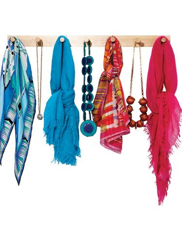 Instead of battling the scarf or necklace octopus that forms when you toss a bunch  in a drawer, mount a basic peg board on  one wall of the closet, and hang each item so they stay separate.