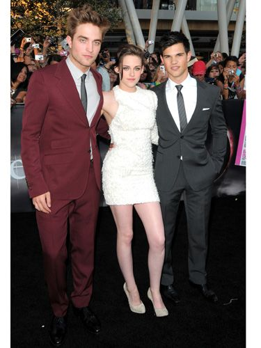 "The hottest Hollywood threesome posed for thousands of screaming Twihards at the LA premiere of <i>Eclipse</i>. For more pics, check out our <a href=""http://www.cosmopolitan.com/celebrity/red-carpet-dresses/eclipse-premiere-los-angeles"" target=""_blank"">sizzling red carpet gallery</a>."