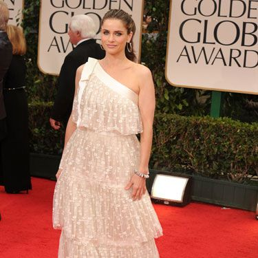You are what you eat, and Amanda Peet is clearly her multi-tiered wedding cake.