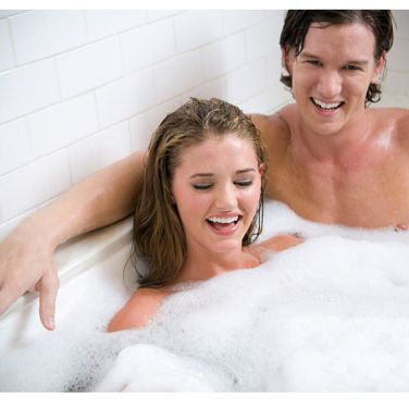 Switch up your routine and get warm by luxuriating in the tub with your guy. Skip the candles and oils — a basic bubble bath is more guy-friendly. To make the dip a deux even steamier, tease him by letting the bubbles cover some of your body while revealing other parts.