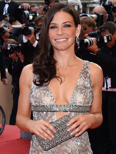 To copy Evangeline Lilly's sexy set, Meredith Baraf, celebrity makeup artist for the Victoria's Secret Fashion Show, suggests putting on your best push-up bra (it sets your boobs in the perfect position), and grabbing a soft powder brush plus two bronzers — one that's darker than your skin, another that's lighter and shimmery.