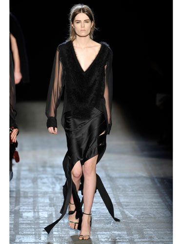 Fur is definitely girl-hot. But sheer sleeves and surprising flashes of skin (check out her left upper thigh) make this look decidedly guy-hot too.