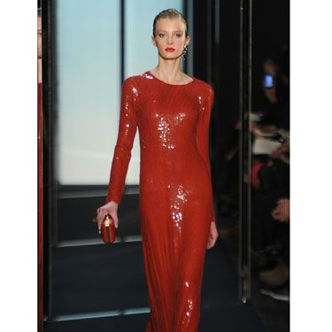 The inventor of the wrap dress just keeps on reinventing herself, this time with a shimmery, curve-hugging red gown.