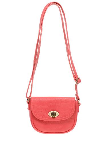 "This cute little saddle bag will brighten up any outfit.   <br /><br />$27, <a href=""http://us.asos.com/Oasis/Oasis-Mini-Festival-Bag/Prod/pgeproduct.aspx?iid=1493765&cid=8730&sh=0&pge=1&pgesize=200&sort=-1&clr=Coral""target=""_blank"">us.asos.com</a>"