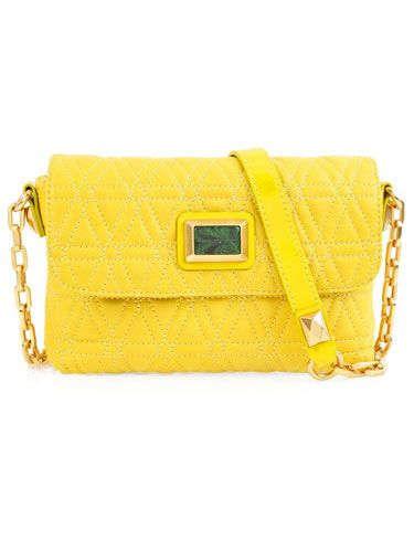 "This splurge bag from Marc by Marc Jacobs is called the ""Cosmo"" so we couldn't resist. It also happens to be the coolest shape and color of the season.   <br /><br />$300, <a href=""http://www.net-a-porter.com/product/98493#""target=""_blank"">net-a-porter.com</a>"