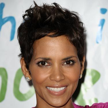 Halle's pixie has the slightest auburn tint. If you're going to go very dark with a short cut, make sure it has a lot of dimension.