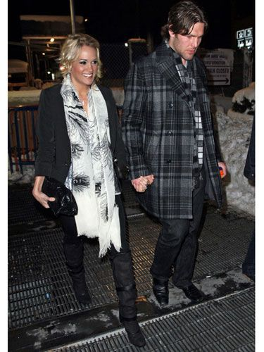 """""""I like to keep it pretty simple—I don't have a a whole lot of time to primp and get ready. Usually a date consists of, 'hey you want to go grab dinner?'""""   <br /><br />  Carrie with her husband, Mike Fisher."""