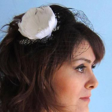 This one's a little retro—we love the polka-dotted feather accent.