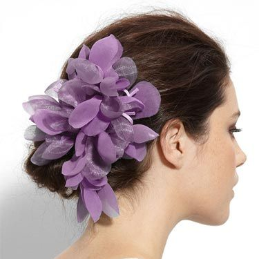 You could make this regal-hued accessory even more royal by clipping it closer to your face. 
