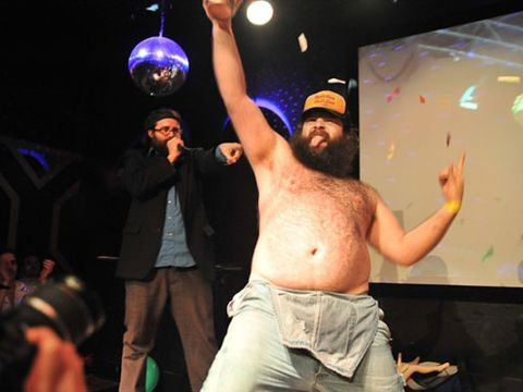 """The annual competition in which men and women take to the stage (fully clothed or at least wearing overalls and a body hair sweater like the specimen at left) to  <a href=""""http://www.jsonline.com/entertainment/120989984.html"""" target=""""_blank"""">mimic having sex with an imaginary partner</a> just wrapped up in Milwaukee. And there are shows this weekend in Boston, Philly, and NYC. Want to see some of the acts? Just do a search on YouTube for """"air sex contest"""" for some of the most NSFW videos you'll ever watch."""