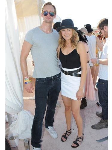 The <i>True Blood</i> hottie cozied up to gal-pal Malin, who rocked a black fedora.