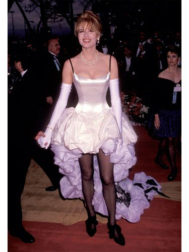 Nominated for her kick-ass role in <i>Thelma and Louise,</i> Geena showed up at the Oscars in a dress that looked like a compilation of parts from a can-can costume, a wedding dress, and a cotillion gown. Those black stockings didn't do very much for the leggy actress either.