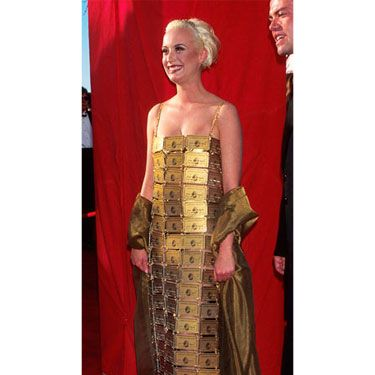 It's a dress made of American Express Gold cards. We're not sure what else to say about this one, except that the obvious lesson is this: For the love of God, do <i>not</i> design your own dress for the red carpet.