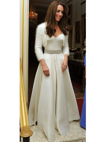 "The fashion empire created both Kate's wedding gown and this evening dress, which changed into for the reception. Little girls everywhere now have very specific fantasies: ""When I grow up, I wanna meet a handsome prince and be a princess and only wear McQueen."""