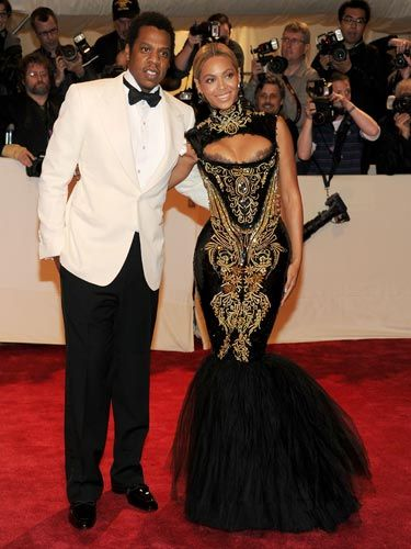 Beyonce's Pucci dress was the epitome of curve-hugging. While her accessories were minimal, she wore her best one—hubby Jay-Z—on her arm.