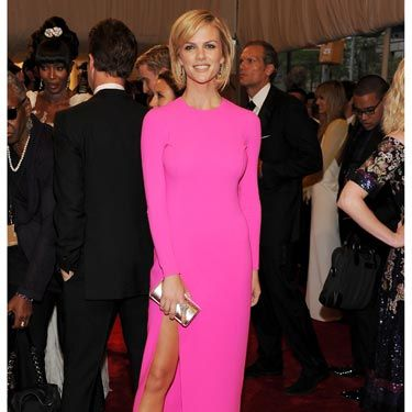 "Brooklyn Decker rocked <a href=""http://www.cosmopolitan.com/hairstyles-beauty/skin-care-makeup/hot-pink-beauty-for-spring-2011"">hot pink</a> Michael Kors in the long-sleeved silhouette that was the top trend of the evening. We love the leg-elongating nude shoes."