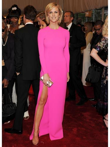 """Brooklyn Decker rocked <a href=""""http://www.cosmopolitan.com/hairstyles-beauty/skin-care-makeup/hot-pink-beauty-for-spring-2011"""">hot pink</a> Michael Kors in the long-sleeved silhouette that was the top trend of the evening. We love the leg-elongating nude shoes."""