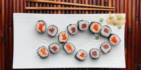 The veggies and seaweed wrap are low-cal, but a lot of the most popular rolls are slathered with cream cheese or mayo (e.g., in that spicy sauce that comes on many options), and the seafood inside may be tempura-battered. Thanks to those ingredients, a standard roll can clock in at 500 to 600 calories. Also, soy sauce is loaded with sodium. It won't make you gain weight, but it'll cause you to retain water, so your jeans will feel (and look) tighter.