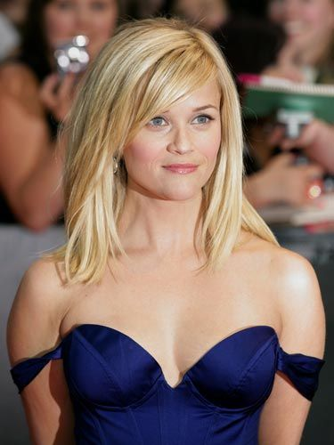 Reese's sexy, <i>royal</i> blue satin bustier cocktail dress was just right for London's state of post-wedding elegance. We love the way her hair and makeup aren't overdone, proving that even if your dress is super-fance, classic beauty always works.