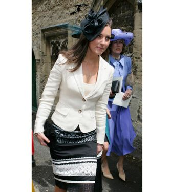 Kate kept it classic and simple—wearing black and white from (literally) head to toe—when she attended a wedding with Wills, then her boyfriend of four years.