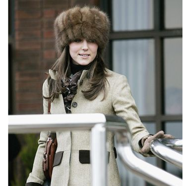 While most women in England opt for whimsical, frilly toppers, Kate turned heads and arrived at the horse races wearing a Russian style fur hat.