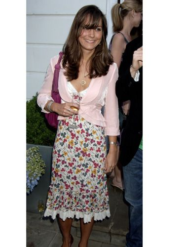 The future princess attended a party in a simple floral dress and pale pink blazer, showing off her feminine side (and a little cleavage).