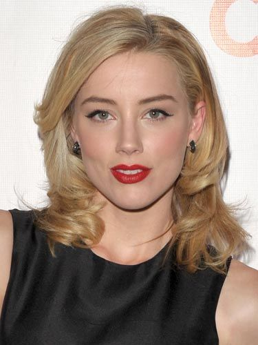 From the red lips to the winged eyeliner, this look screams sexy screen siren.
