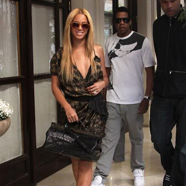 Beyonce hit the town in Paris with hubby Jay-Z—and an entourage, natch—looking better than we've ever seen. We love the asymmetrical dress and the gold platforms.
