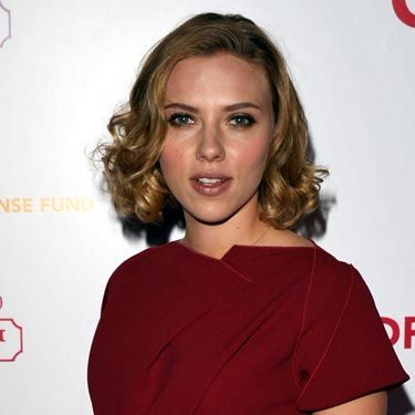 Isn't it amazing how ScarJo can make even a very high neckline look anything but conservative?