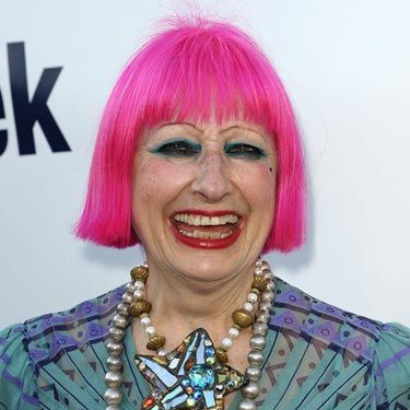 We know pink hair is a trend, but paired with the necklace and makeup, this zany British designer is taking it to a whole new level.