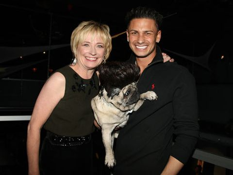"""""""Is this a smush room?"""" wondered Cosmo's Editor-in-Chief Kate White before posing with Pauly and Puggy."""