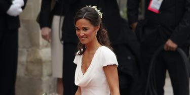 On the Big Day, Pippa was perfectly composed and truly elegant in a cowl-neck white dress by Alexander McQueen.