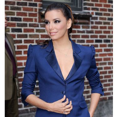 Eva Longoria wore this hot number on <i>Letterman</i> and almost had a nip-slip. (Learn from her mistake and invest in fashion tape before donning this revealing menswear look.)