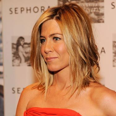"""Jennifer Aniston and her twins stepped out earlier in the week and made us all want to race out and get a cut-out top like this. (Psst, <a href=""""http://www.cosmopolitan.com/celebrity/fashion/met-costume-institute-gala-2011-pictures"""" target=""""_blank"""">Beyoncé rocked a similar—and equally sexy—look</a>.)"""