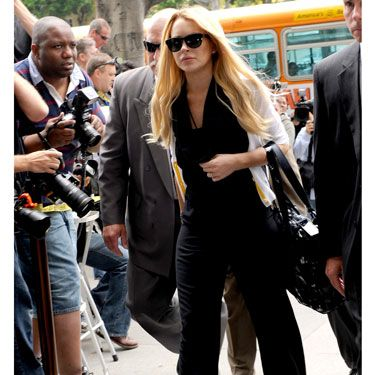 Lindsay showed up wearing a very chic black and white ensemble, but it was her nails everyone was checking out. She had written <a href="