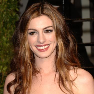 A pretty, rumpled style like Anne Hathaway wore to the Oscars is a great way to spice up basic long hair. And it's really simple—just mist in some texturizing spray and scrunch.