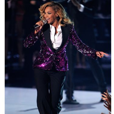 Beyoncé showed off her new baby bump in a sparkly, purple tuxedo jacket and pants by Dolce & Gabbana. The menswear trend has never looked this good.