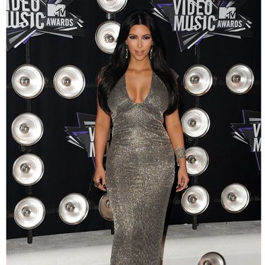 This body-hugging, glittery, metallic gown is classic Kardashian in the best way.