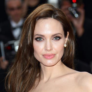 "Angelina Jolie's sexy look is all about smoky eyes in rich shades of brown. Use a palette of different hues, like <a href=""http://www.drugstore.com/rimmel-glam-eyes-quad-eye-shadow-palette-smokey-brun-002/qxp345250""target=""_blank"">Rimmel Glam Eyes Quad</a>, focusing the darkest color around your lashline and blending outward."