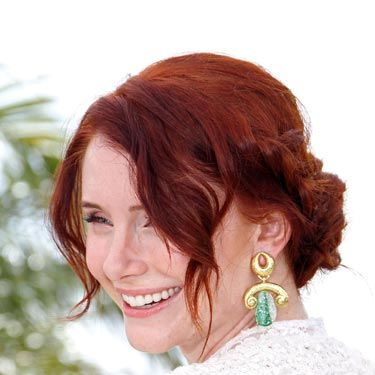 "<a href=""http://www.cosmopolitan.com/hairstyles-beauty/hair-care/celebrities-with-red-hair-2011"">Red-head</a> Bryce Dallas Howard gives off a casual, hippie-ish vibe with her tresses pulled back into a braided updo. To get the look, create two loose French braids on either side of your face, weave them together into a bun-like style and pin them in place."