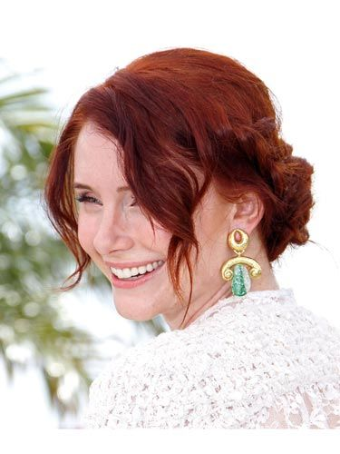 """<a href=""""http://www.cosmopolitan.com/hairstyles-beauty/hair-care/celebrities-with-red-hair-2011"""">Red-head</a> Bryce Dallas Howard gives off a casual, hippie-ish vibe with her tresses pulled back into a braided updo. To get the look, create two loose French braids on either side of your face, weave them together into a bun-like style and pin them in place."""
