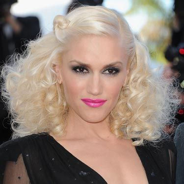 "Gwen Stefani isn't known for holding back. Here, she really went for it with big curls, inky eyes and bold lips. Create a toned-down version of her eye-lip combo with black liquid liner and a lip color like <a href=""http://www.lorealparisusa.com/_us/_en/default.aspx#/?page=top{userdata//d+d//